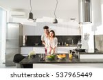 young couple embrace in kitchen ... | Shutterstock . vector #537965449