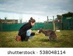 Woman Feeding Wallaby In...