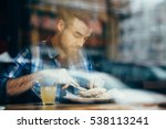 handsome young man having lunch ... | Shutterstock . vector #538113241