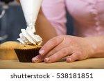Female Baker Hands Decorating...