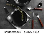 black plate and cutlery on gray ... | Shutterstock . vector #538224115