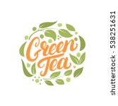 Stock vector green tea hand written lettering logo label badge emblem with leaves and flowers isolated on 538251631