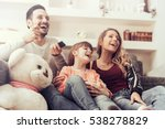 young family watching tv... | Shutterstock . vector #538278829