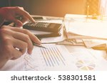 man holding pen and calculating ... | Shutterstock . vector #538301581