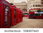 Red Telephone Box And Bus In...