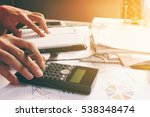 asian young man calculating... | Shutterstock . vector #538348474