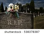Flowers On A Headstones In A...