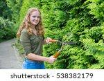 caucasian teenage girl pruning... | Shutterstock . vector #538382179