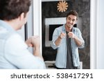 smiling young man pointing... | Shutterstock . vector #538417291
