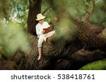 a boy in a straw hat reading a... | Shutterstock . vector #538418761