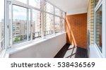 glazed balcony with brick wall | Shutterstock . vector #538436569