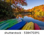 Beached Kayaks And Autumn Colo...
