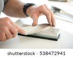 man sharpening knife in...   Shutterstock . vector #538472941