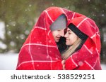 couple under a red blanket in... | Shutterstock . vector #538529251