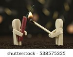 One male holds boilers - the second with burning match - stock photo