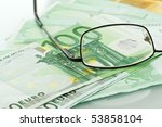 eyeglasses and currencies | Shutterstock . vector #53858104