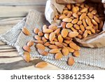 almonds  pour out on wooden...   Shutterstock . vector #538612534