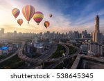 Hot Air Balloons Over Cityscape