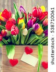 tulips in the box on wooden... | Shutterstock . vector #538710061