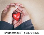 hand holding a red heart ... | Shutterstock . vector #538714531