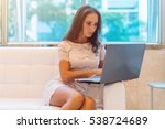 young woman sitting on sofa at... | Shutterstock . vector #538724689
