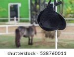 helmet jockey hang on iron pole ...   Shutterstock . vector #538760011