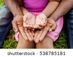 hands of family together in... | Shutterstock . vector #538785181