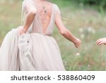 Couple In Wedding Attire With ...