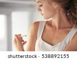 woman injecting hand at home | Shutterstock . vector #538892155