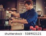 handsome barista preparing cup... | Shutterstock . vector #538902121