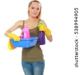 Small photo of Cheerful woman is cleaning something with wisp and spray attentively.