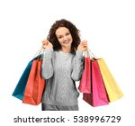 Happy Woman Holding Shopping...