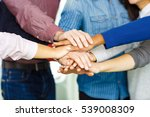 colleagues piling their hands... | Shutterstock . vector #539008309