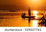 Fisherman On Wooden Boat...