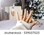diamond ring on a finger under... | Shutterstock . vector #539037025