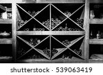 Small photo of Store of old bottles of wine in cellar. Close up.