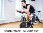 athlete man biking in the gym ... | Shutterstock . vector #539085559