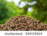 Wood Pellets On A Green...