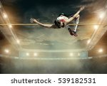 athlete in action of high jump. | Shutterstock . vector #539182531