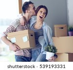 happy young couple unpacking or ... | Shutterstock . vector #539193331