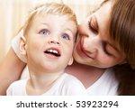 happy young mother hugging her... | Shutterstock . vector #53923294
