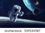 astronaut at spacewalk. cosmic...   Shutterstock . vector #539234587