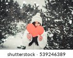 beautiful young woman holding a ... | Shutterstock . vector #539246389