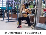 fit girl doing lunges with the... | Shutterstock . vector #539284585