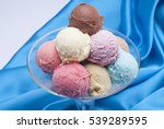 Stock photo mixed ice cream scoops in cup 539289595