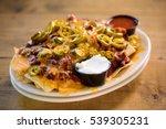 loaded nachos pub food. | Shutterstock . vector #539305231