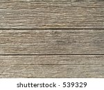 This is a textured background shot of some weathered wood. - stock photo