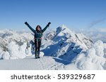 A Woman Hiker On The Summit Of...