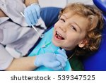 smiling child sitting in a blue ... | Shutterstock . vector #539347525