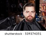 young handsome barber making...   Shutterstock . vector #539374351
